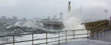 Coastal Storm buffets pier and lighthouse