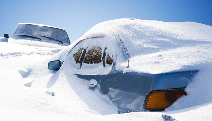 Cars Covered in Heavy Snow