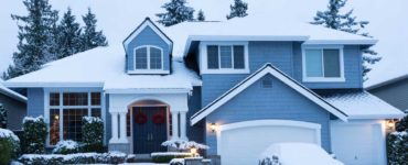Suburban home under a thick layer of snow