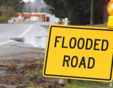 Flash Flood warning sign on the side of the road