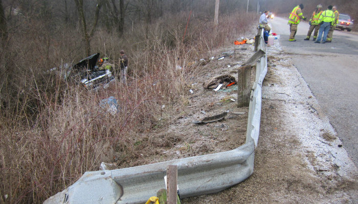 Pickup truck overturned in forest off highway road