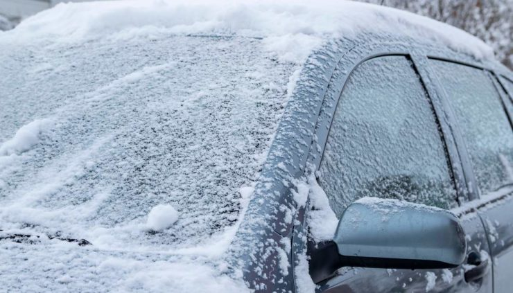 a car covered in snow and ice from a winter storm