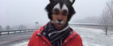 a reporter with a cat filter