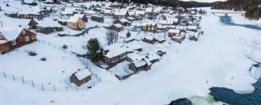 an aerial view of a small town covered in snow