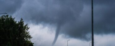a small tornado is shown during a storm