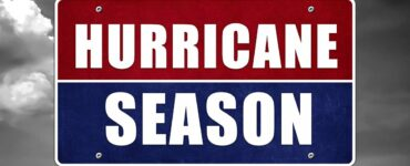 a stormy background with a sign that reads Hurrican Season in blue and red