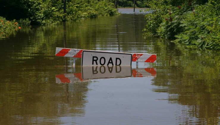a flooded road sign