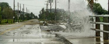 water coming over a road during a storm