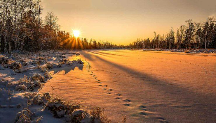 sun setting over snow