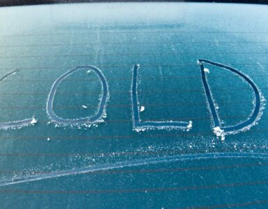 a car with the word cold written in frost