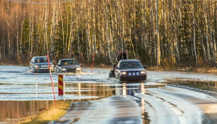 cars driving through a flooded out road