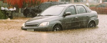 car stuck in flood waters