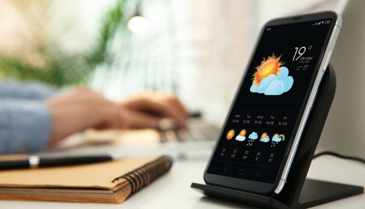 weather forecast displayed on smartphone, sitting on desk