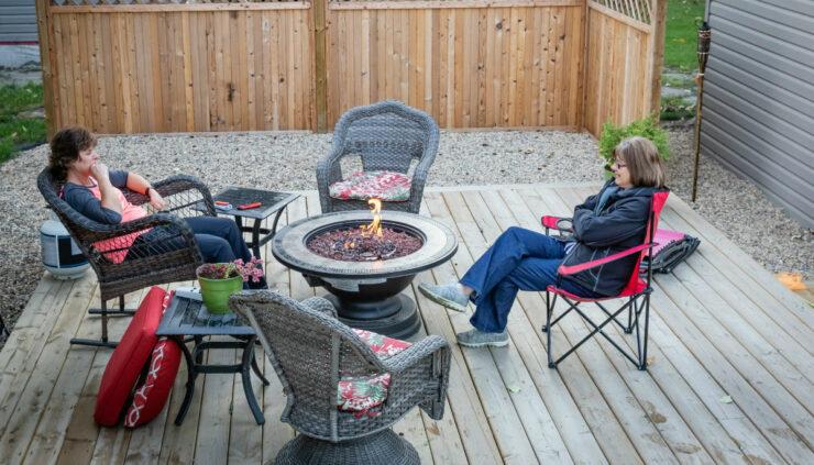 women sitting around fire pit