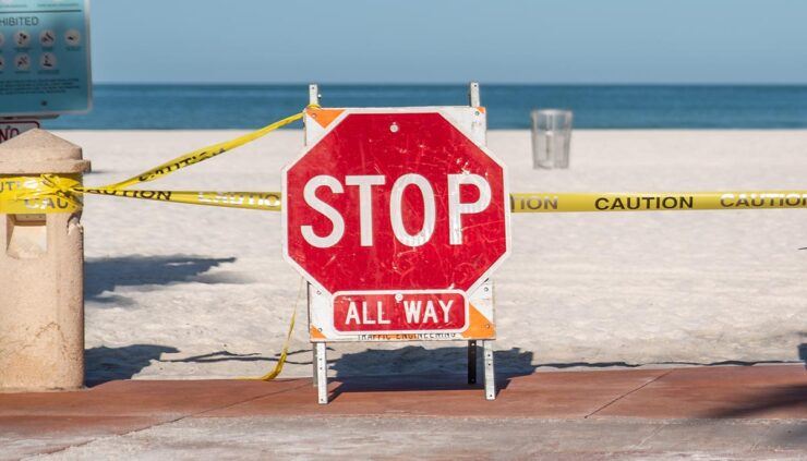 beach with closed signs