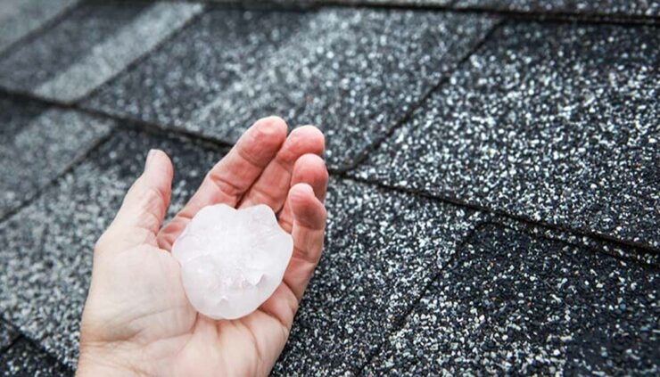 large hail in hand near roof