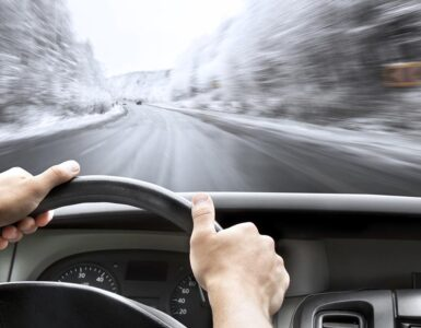 man driving fast in snow