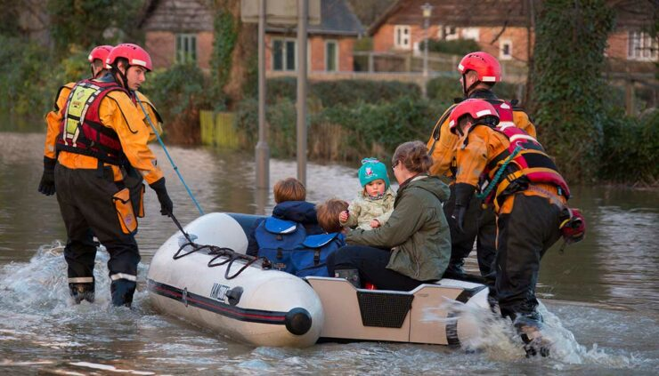 people get rescued from floods