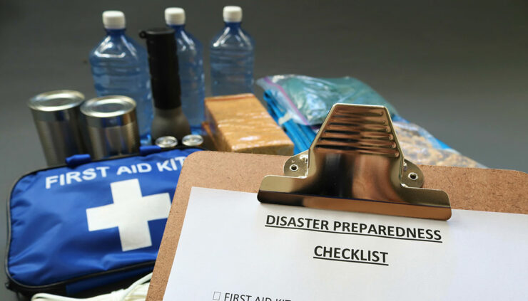evacuation prep, checklist with a first aid kit, water, and nonperishable foods