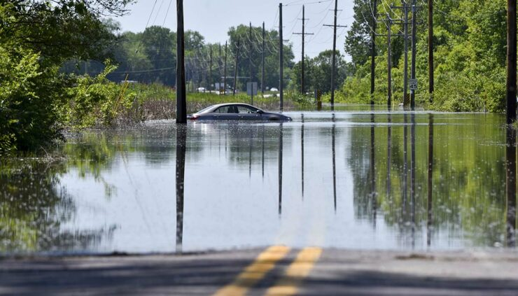 flooded road with a car submerged