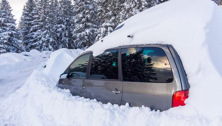 a car buried in snow