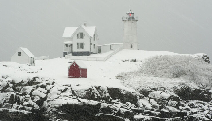 New England lighthouse in a snowstorm