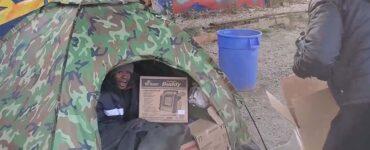 homeless man is given winter basics