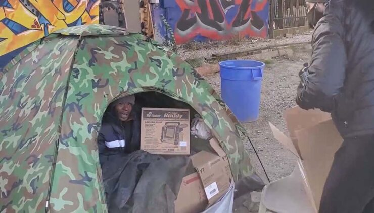 homeless man is given winter basics