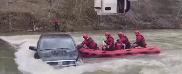 family trapped in car during flood