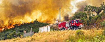 fire truck races toward brushfire