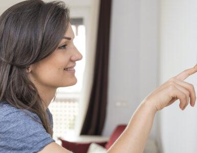 person-adjusting-thermostat