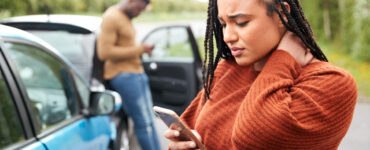 woman-looking-at-phone-after-wreck