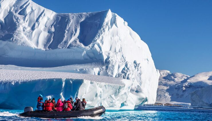 Tourists in a boat exploring Antarctica